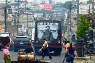 """Installation on public buses of the Angel of Memory denouncing """"Yes, there was Genocide"""". This action took place at the same time the trial for Genocide against Efraín Rios Montt was going on at the Supreme Court big impact on public opinion. Guatemala City 23/05/13."""
