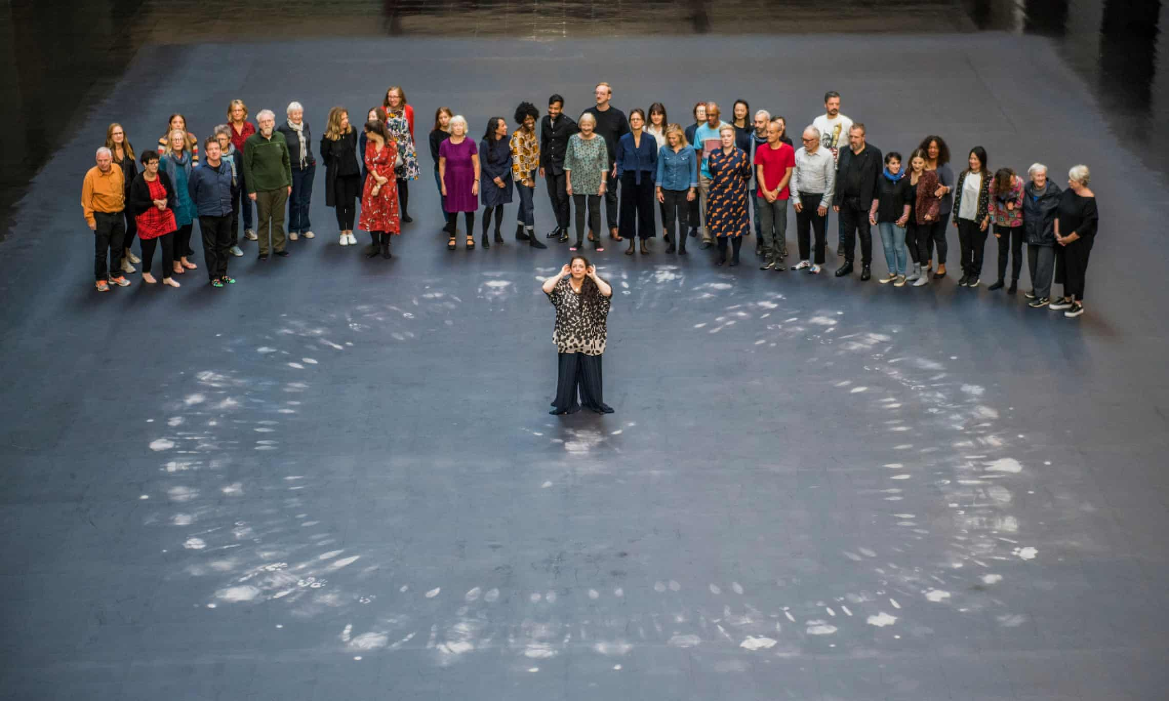 Body count … Tania Bruguera (centre) stands on the heat-sensitive floor of her Turbine Hall commission at Tate Modern. Photograph: Guy Bell/Rex/Shutterstock